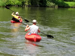 Two kayakers enjoying the beauty of the Kalamazoo River